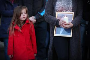Daughter of Michael McGibbon joins members of the public at a vigil in the grounds of Holy Cross Church, Ardoyne. Photo by Kelvin Boyes / Press Eye