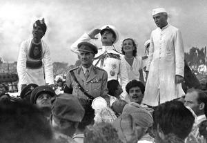 In this file photo taken in August 1947 and released by Indian Ministry of Defense, Indian last Governor General Lord Mountbatten salutes the Indian national flag hosted at India Gate as Lady Edwina, second right, and India's first prime minister Jawaharlal Nehru,right, looks on, during independence day celebrations, in New Delhi, India, August 1947. Sixty years ago this month, India and Pakistan won their Independence, now Pakistan, no stranger to domestic turmoil, is embroiled in an increasingly violent struggle between Islamic extremists and moderates, where as India is racing to become an economic powerhouse, lightning growth has transformed the country and fueled a consumer boom. (AP Photo/Indian Ministry of Defense, HO, File)