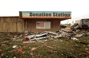 MOORE, OK- MAY 20:  A Goodwill donation station is surrounded by debris after a powerful tornado ripped through the area on May 20, 2013 in Moore, Oklahoma. The tornado, reported to be at least EF4 strength and two miles wide, touched down in the Oklahoma City area on Monday killing at least 51 people. (Photo by Brett Deering/Getty Images)
