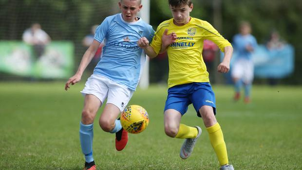 PressEye-Northern Ireland- 1st August 2019-Picture by Brian Little/PressEye Dungannon United Youth Jack McKee and  Ballymena United Robbie Spiers  in  STATSports SuperCupNI  Semi Final , at Anderson Park, Coleraine . Picture by Brian Little/PressEye