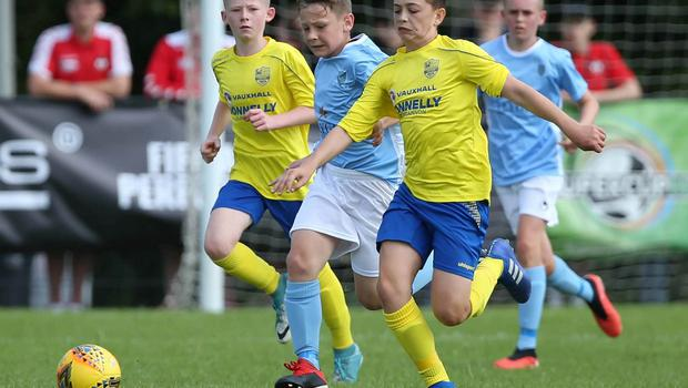 PressEye-Northern Ireland- 1st August 2019-Picture by Brian Little/PressEye Dungannon United Youth Ryan Donnelly  and Ballymena United Marc Faulkner   in  STATSports SuperCupNI  Semi Final , at Anderson Park, Coleraine . Picture by Brian Little/PressEye