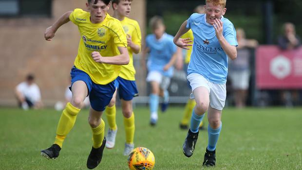 PressEye-Northern Ireland- 1st August 2019-Picture by Brian Little/PressEye Dungannon United Youth Jack Quinn   and Ballymena United   Michael Leetch in  STATSports SuperCupNI  Semi Final , at Anderson Park, Coleraine . Picture by Brian Little/PressEye