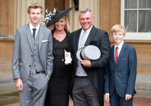 Darren Clarke poses with his wife Alison and  sons, Tyrone (L) and Conor after being awarded an OBE at Buckingham Palace for services to golf at Buckingham Palace on November 21, 2012 in London, England. (Photo by Mark Large - WPA Pool/Getty Images)