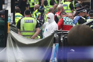 Police and forensic officers at the scene in West George Street, Glasgow (Andrew Milligan/PA)