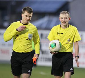 Gareth Eaking (left) in action with referee Keith Kennedy.