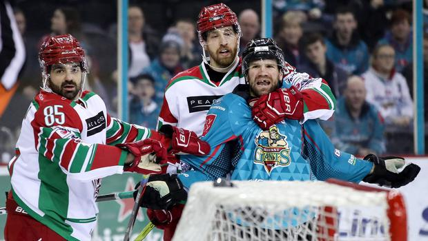 Belfast Giants winger Bobby Farnham comes to blows with Cardiff Devils winger Sean Bentivoglio and defenceman Shaone Morrisonn during Saturday night's game at the SSE Arena (William Cherry/Presseye)