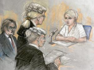 Amber Heard being cross examined by Eleanor Laws QC (Elizabeth Cook/PA)