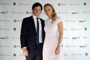 AUGUSTA, GA - APRIL 10:  Rory McIlroy of Northern Ireland and Caroline Wozniacki of Denmark attend the US Golf Writers Dinner on April 10, 2013 in Augusta, Georgia.  (Photo by Andrew Redington/Getty Images)