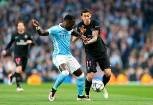 Manchester City's Bacary Sagna (left) and Paris Saint-Germain's Angel Di Maria (right) battle for the ball during the UEFA Champions League Quarter Final, Second Leg match at the Etihad Stadium, Manchester. Photo: Martin Rickett/PA Wire