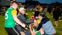 Controversy: Fans invading the pitch after the Thomas Clarkes GAA Club won the Tyrone senior football final