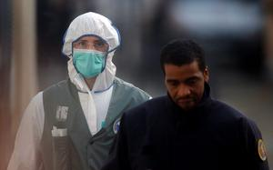 A forensic expert walks from the scene in Saint-Denis, near Paris, Wednesday, Nov. 18, 2015. A woman wearing an explosive suicide vest blew herself up Wednesday as heavily armed police tried to storm a suburban Paris apartment where the suspected mastermind of last week's attacks was believed to be holed up, police said. (AP Photo/Michel Euler)