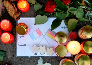A drawing showing the French and the German flag is laid down on November 16, 2015 with flowers and candles in front of the French consulate general in Duesseldorf, western Germany, in solidarity with French people after the attacks in Paris.     AFP PHOTO / DPA / MONIKA SKOLIMOWSKA   +++   GERMANY OUT   +++MONIKA SKOLIMOWSKA/AFP/Getty Images