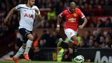 Tottenham Hotspur's Nacer Chadli challenges Manchester United's  Ashley Young during the Barclays Premier League match at Old Trafford, Manchester. Jon Buckle/PA Wire.