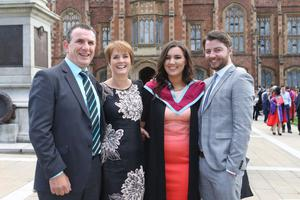 Trudy Anderson from Lurgan celebrates her graduation at Queens University alongside her dad Trevor, mum Helen and boyfriend Ross Uprichard. Trudy graduated with a Masters in Architecture. Photo/Paul McErlane