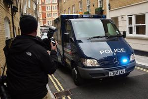 A police convoy carrying suspected IRA bomber John Anthony Downey arrives at Westminster Magistrates Court on May 22, 2013 in London