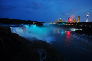 Visitors to Niagara Falls receive notice of the sex of the royal baby indicated by the blue light illuminating the falls in Niagara Falls, New York. The Royal couple,The Duke and Duchess of Cambridge, had a baby boy who was born at 16.24 BST and weighed 8 pounds, 6 ounces. The child, who is now third in line to the throne, has yet to be named.  (Photo by John Normile/Getty Images)