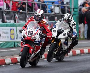 Conor Cummins (Honda Racing)  and Michael Dunlop (BMW Motorrad) battle for position during Eventserv Superbike Race during  at the Vauxhall International 2014  North West 200. Picture by  Brian Little/Presseye