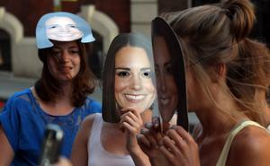 Women wearing Duchess of Cambridge masks pretend to be pregnant outside the Lindo Wing of St Mary's Hospital, London. Lewis Whyld/PA Wire