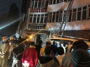 Firefighters rescue people at the Arpit Palace Hotel (Sivanand Chand via AP)