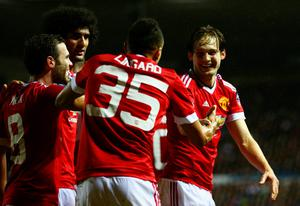 Daley Blind of Manchester United (R) celebrates with Jesse Lingard (35) and team mates as he scores their second goal during the Emirates FA Cup fourth round match between Derby County and Manchester United at iPro Stadium on January 29, 2016 in Derby, England.  (Photo by Clive Mason/Getty Images)