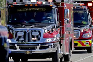 Fire rescue vehicles converge at Marjory Stoneman Douglas High School  following a shooting in Parkland, Fla., on Wednesday, Feb. 14, 2018. (John McCall/South Florida Sun-Sentinel via AP)