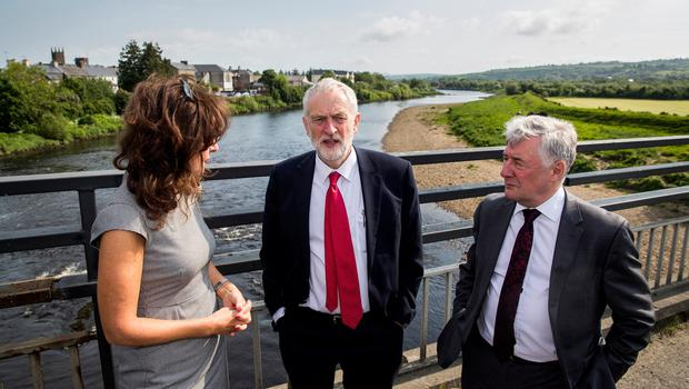 Labour leader Jeremy Corbyn with Professor Deirdre Heenan (left) and Shadow Secretary of State for Northern Ireland Tony Lloyd (right) during a visit to Lifford Bridge on the Irish border, during the second day of a two-day trip to learn more about how Brexit affects the country. PRESS ASSOCIATION Photo. Picture date: Friday May 25, 2018. See PA story ULSTER Corbyn. Photo credit should read: Liam McBurney/PA Wire