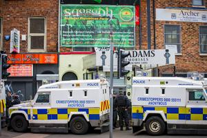 Heavily armed officers carry out a search operation in relation to serious Dissident Republican Activity at the Saoradh offices in west Belfast on June 12th 2017 (Photo by Kevin Scott / Belfast Telegraph)