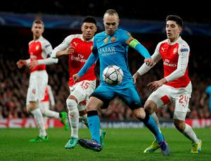 Barcelona's midfielder Andres Iniesta (2R) vies with Arsenal's German defender Per Mertesacker (L), Arsenal's English midfielder Alex Oxlade-Chamberlain (2L) and Arsenal's Spanish defender Hector Bellerin during the UEFA Champions League round of 16 1st leg football match between Arsenal and Barcelona at the Emirates Stadium in London on February 23, 2016.   / AFP / ADRIAN DENNISADRIAN DENNIS/AFP/Getty Images