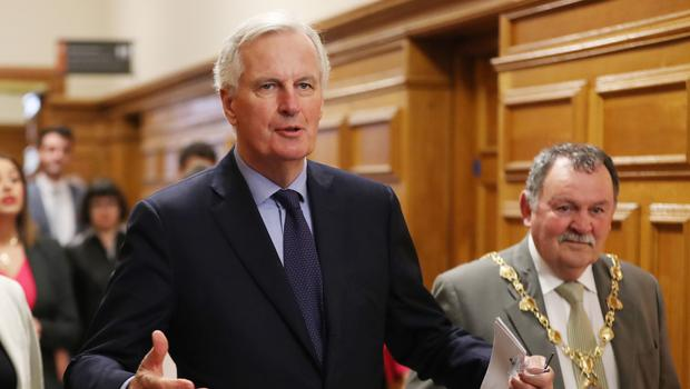 Michel Barnier is greeted by Mayor Maoliosa McHugh as he arrives at the Guildhall in Derry (Niall Carson/PA)