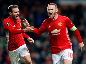 Manchester United's Wayne Rooney (right) celebrates scoring his side's first goal of the game with teammate Juan Mata during the UEFA Europa League match at Old Trafford, Manchester. PA