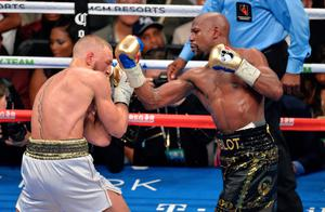 Floyd Mayweather Jnr and Conor McGregor during their fight at the T-Mobile Arena, Las Vegas. PRESS ASSOCIATION Photo. Picture date: Saturday August 26, 2017. See PA story BOXING Las Vegas. Photo credit should read: PA Wire/PA Wire. RESTRICTIONS: Editorial use only. No commercial use.