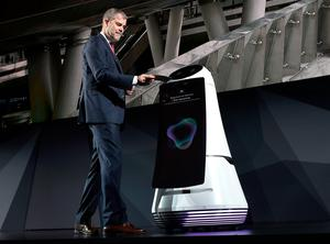 LAS VEGAS, NV - JANUARY 04:  LG Electronics USA Vice President of Marketing David VanderWaal displays the Airport Guide Robot during a LG press event for CES 2017 at the Mandalay Bay Convention Center on January 4, 2017 in Las Vegas, Nevada. CES, the world's largest annual consumer technology trade show, runs from January 5-8 and is expected to feature 3,800 exhibitors showing off their latest products and services to more than 165,000 attendees.  (Photo by David Becker/Getty Images)