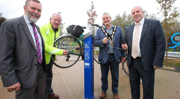 Pictured at the first cycle repair station in Northern Ireland, which is located within the grounds of the Billy Neill Soccer Centre of Excellence are: Andrew Grieve, Head of Cycling and Inland Waterway, DfI; Gordon Clarke, National Director, Sustrans; the Mayor, Councillor Tim Morrow and Alderman James Tinsley, Chairman of the Council's Leisure & Community Development Committee.