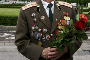 A man wears a uniform displaying badges, medals, badge of honor, awards to commemorate Victory Day, when Nazi Germany surrendered to the Soviet Union on May 9, 1945, at the Soviet war cemetery and memorial in Treptow Park on May 9, 2014 in Berlin, Germany. The annual gathering at the memorial usually draws a mix of leftists and people from the former Soviet Union as well German people.  (Photo by Carsten Koall/Getty Images)