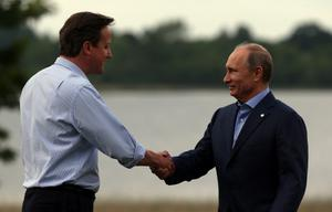 ENNISKILLEN, NORTHERN IRELAND - JUNE 17:  President Vladimir Putin is greeted by Britain's Prime Minister David Cameron (L) at the official arrival of the G8 leaders at the G8 venue of Lough Erne on June 17, 2013 in Enniskillen, Northern Ireland. The two day G8 summit, hosted by UK Prime Minister David Cameron, is being held in Northern Ireland for the first time. Leaders from the G8 nations have gathered to discuss numerous topics with the situation in Syria expected to dominate the talks.  (Photo by Matt Cardy/Getty Images)