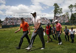 ARDMORE, PA - JUNE 14:  Rory McIlroy of Northern Ireland, Tiger Woods of the United States and Adam Scott of Australia walk with their caddies off the 17th hole during Round Two of the 113th U.S. Open at Merion Golf Club on June 14, 2013 in Ardmore, Pennsylvania.  (Photo by Scott Halleran/Getty Images)