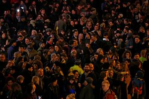 LONDON, ENGLAND - JANUARY 11: People gather to listen to David Bowie songs as they celebrate his life in Brixton on January 11, 2016 in London, England. British music and fashion icon David Bowie died earlier today at the age of 69 after a battle with cancer. (Photo by Carl Court/Getty Images)