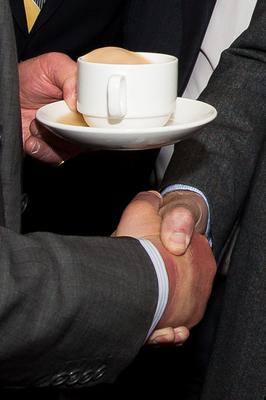 Close up of the handshake between Gerry Adams and Prince Charles