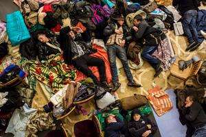 KIEV, UKRAINE - DECEMBER 7: Anti-government protesters sleep on the floor of the occupied Kiev City Hall on December 7, 2013 in Kiev, Ukraine. Thousands of people have been protesting against the government since a decision by Ukrainian president Viktor Yanukovych to suspend a trade and partnership agreement with the European Union in favor of incentives from Russia. (Photo by Brendan Hoffman/Getty Images)