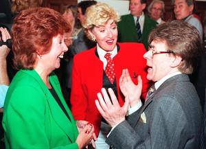 Cilla Black (left) and comedienne Faith Brown are entertained by comedian Mike Yarwood at the unveiling of a plaque in honour of Bill Cotton in London. Neil Munns/PA Wire.