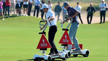 Rory McIlroy of Northern Ireland and Jordan Spieth of the United States pictured riding a Golfboard in The Rider Cup Desert Challenge at Saadiyat Beach Golf Club prior to the Abu Dhabi HSBC Golf Championship on January 19, 2016 in Abu Dhabi, United Arab Emirates.  (Photo by Ross Kinnaird/Getty Images)