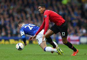 LIVERPOOL, ENGLAND - APRIL 20:  Ross Barkley of Everton is fouled by Chris Smalling of Manchester United during the Barclays Premier League match between Everton and Manchester United at Goodison Park on April 20, 2014 in Liverpool, England.  (Photo by Alex Livesey/Getty Images)