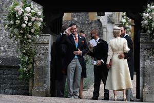 ENGLEFIELD, ENGLAND - MAY 20: Spencer Matthews, left, gestures as he stands with James Middleton, right, and Donna Air at the entrance of St Mark's Church ahead of the wedding of Pippa Middleton and James Matthews on May 20, 2017 in Englefield, England. Middleton, the sister of Catherine, Duchess of Cambridge is to marry hedge fund manager James Matthews in a ceremony Saturday where her niece and nephew Prince George and Princess Charlotte are in the wedding party, along with sister Kate and princes Harry and William. (Photo by Kirsty Wigglesworth - Pool/Getty Images)