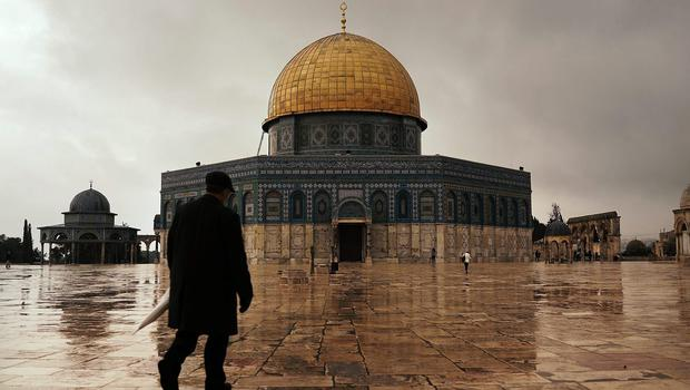 A man walks towards the Dome of the Rock at the Al-Aqsa mosque compound in the Old City on November 27, 2014 in Jerusalem, Israel.  The Dome of the Rock is the fought over holy site between Jews and Muslims and is the prime attraction of the Haram es-Sharif (Noble Sanctuary) or Temple Mount, which is also sacred to Jews.  (Photo by Spencer Platt/Getty Images)
