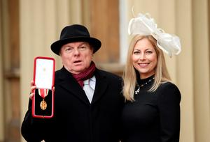 Singer, songwriter and musician Sir Van Morrison at Buckingham Palace, London, with daughter Shana Morrison after he was knighted by the Prince of Wales.