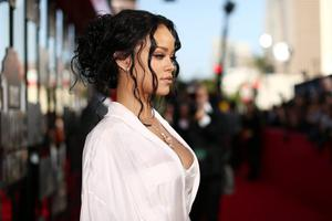 Recording artist Rihanna attends the 2014 MTV Movie Awards at Nokia Theatre L.A. Live on April 13, 2014 in Los Angeles, California.  (Photo by Christopher Polk/Getty Images for MTV)