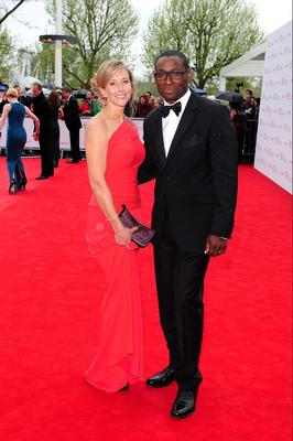 David Harewood and wife Kirsty Handy arriving for the 2013 Arqiva British Academy Television Awards at the Royal Festival Hall, London. PRESS ASSOCIATION Photo. Picture date: Sunday May 12, 2013. See PA story SHOWBIZ Bafta. Photo credit should read: Ian West/PA Wire