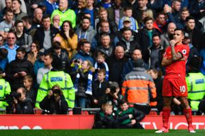 Liverpool's Brazilian midfielder Philippe Coutinho celebrates after scoring their second goal during the English Premier League football match between Liverpool and Everton at Anfield in Liverpool, north west England on April 1, 2017. / AFP/Getty Images