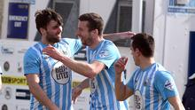 Warrenpoint's Stephen Murray celebrates with Johnny McMurray (left) after scoring his side's second goal against Portadown