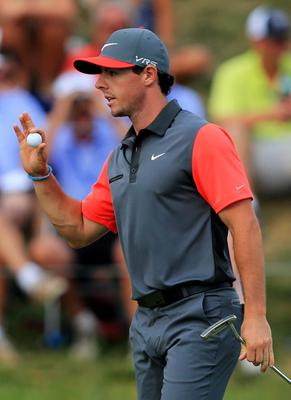 LOUISVILLE, KY - AUGUST 07:  Rory McIlroy of Northern Ireland waves on the 18th green during the first round of the 96th PGA Championship at Valhalla Golf Club on August 7, 2014 in Louisville, Kentucky.  (Photo by David Cannon/Getty Images)